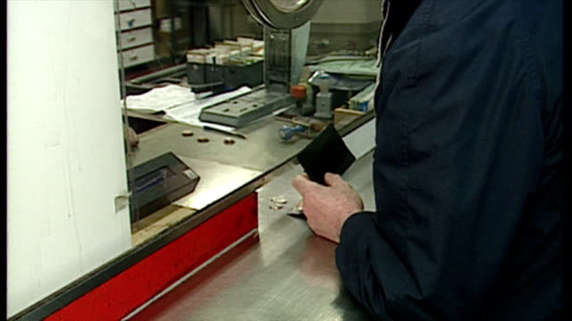 stockvideo's en b-roll-footage met interior shots, customers buying tickets in euston station on november 18, 1994 in london, england. - loterijlootje