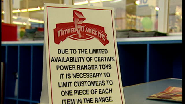 interior shots customers entering toys r us store to purchase power rangers toys, the 1994 christmas craze. signage saying power ranger toys are... - toys r us stock videos & royalty-free footage