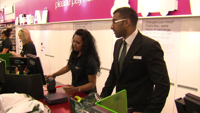 interior shots customers paying at marks spencer payment counters interior shots people dealing with cashier at instore banking service interior... - business finance and industry stock videos & royalty-free footage