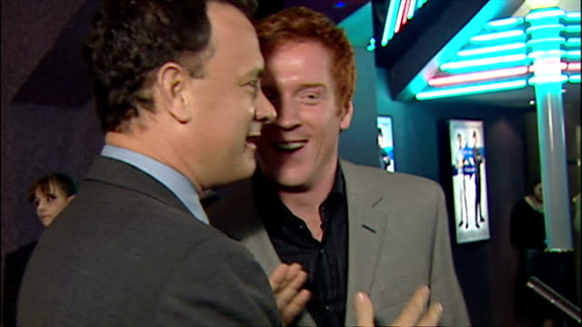 Interior shots Damian Lewis chatting to Tom Hanks at Catch Me if You Can premiere