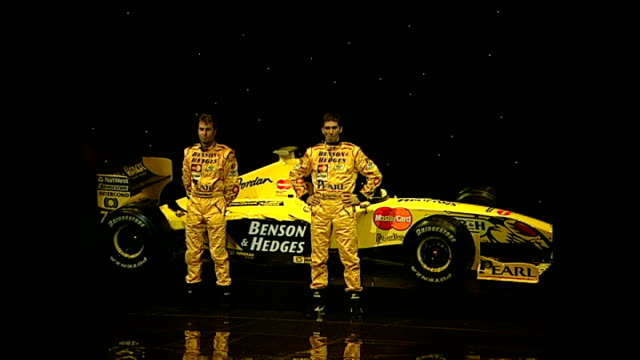 interior shots dancers remove cover to reveal new jordan grand prix formula one car with eddie jordan team owner and drivers heinzharald frentzen and... - removing stock videos & royalty-free footage