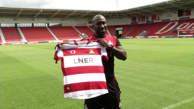 interior shots darren moore, shirt shots , after joining darlington fc as manager at the northern echo arena, home of darlington football club, on... - darlington north east england stock videos & royalty-free footage