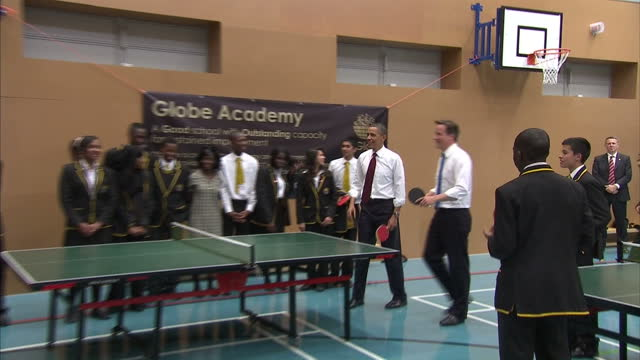 interior shots david cameron & barack obama playing table tennis with school boys at the globe academy in southwark including high fiving each other... - table tennis stock videos & royalty-free footage