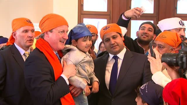 interior shots david cameron leader of conservative party prime minister wearing orange turban and wife samantha cameron samcam wearing headscarf... - turban stock videos & royalty-free footage