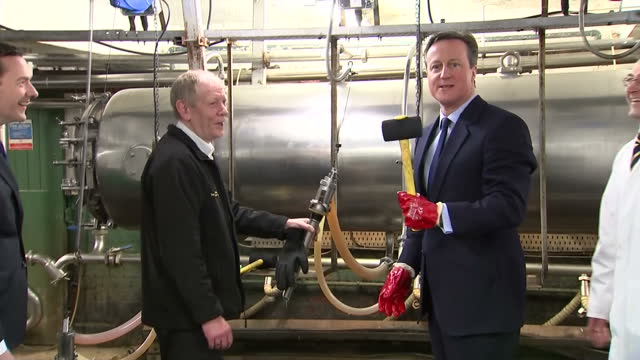 interior shots david cameron prime minister hammers a sealing stopper into a beer barrel during a visit to the marston's brewery on april 01 2015 in... - cork stopper stock videos & royalty-free footage