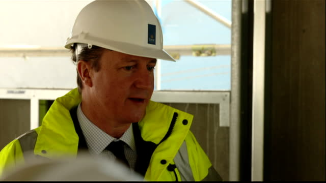 interior shots david cameron, prime minister wearing hard hat and high visibility jacket whilst on visit to crest nicholson 565 london road... - prime minister video stock e b–roll