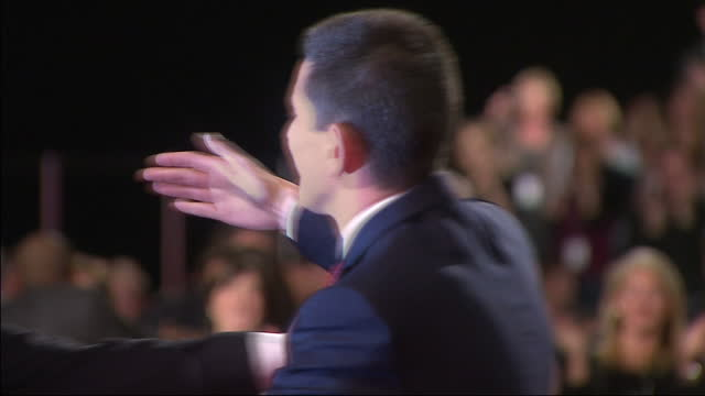 interior shots david ed miliband embrace each other after ed miliband was announced as the new leader of the labour party by beating his brother by... - ed miliband stock-videos und b-roll-filmmaterial