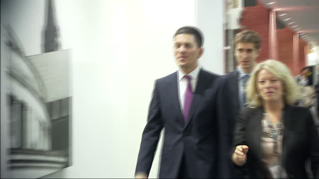 interior shots david miliband walks with his aides being hounded by the media as he negotiates his way through a press scrum david miliband departs... - david miliband stock videos & royalty-free footage