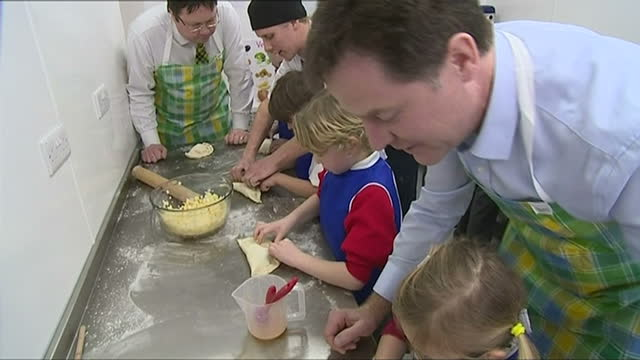 interior shots deputy prime minister wearing apron making cornish pasty with school children at st merryn school on march 05 2015 in padstow england - british liberal democratic party stock videos and b-roll footage