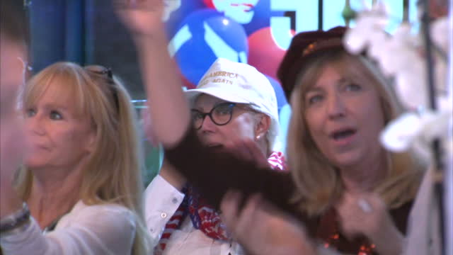 interior shots donald trump supporters watching us presidential election coverage on tvs in bar on november 09 2016 in tampa florida - unterstützer stock-videos und b-roll-filmmaterial
