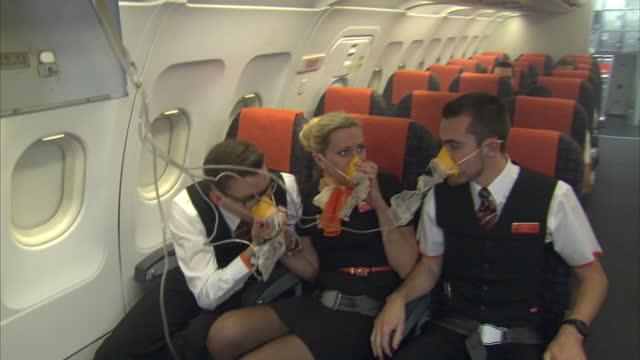 interior shots easyjet trainee cabin crew taking part in emergency flight training on replica plane at easyjet's new training academy at gatwick... - crew stock videos & royalty-free footage
