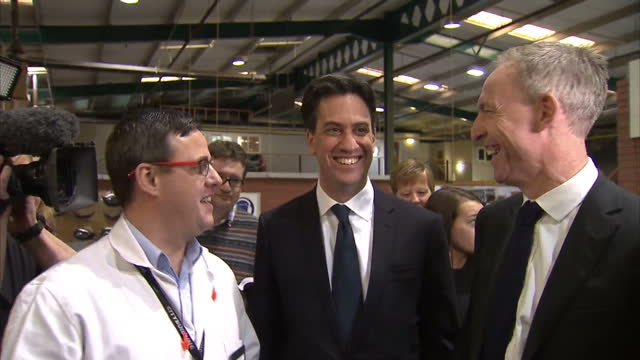 GLASGOW SCOTLAND interior shots Ed Miliband and Jim Murphy talk with staff and students at City Building training facility while students hammer...