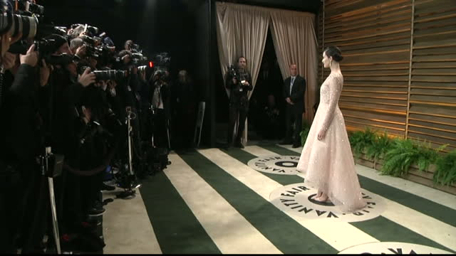 Interior shots Emmy Rossum on red carpet posing for photos on March 02 2014 in Los Angeles California