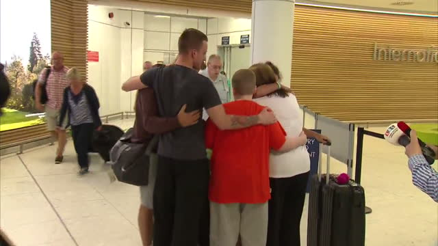 interior shots emotional family and friends welcome home people returning from tunisia after hotel terror attack in airport arrivals hall. on june... - the glasgow airport attack stock videos & royalty-free footage