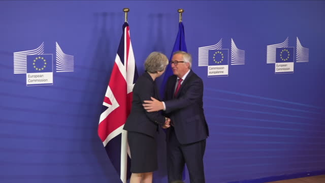interior shots european commission president jeanclaude juncker shakes hands with british prime minister theresa may as she arrives for a bilateral... - theresa may stock videos & royalty-free footage