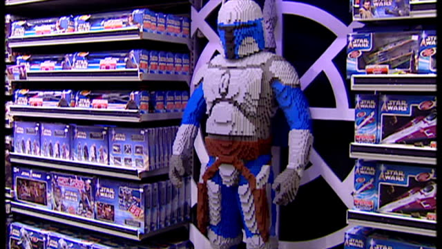 interior shots father and son looking at star wars toys on shelves in toy shop and various star wars merchandise on shelves with life size lego clone... - star wars stock videos & royalty-free footage