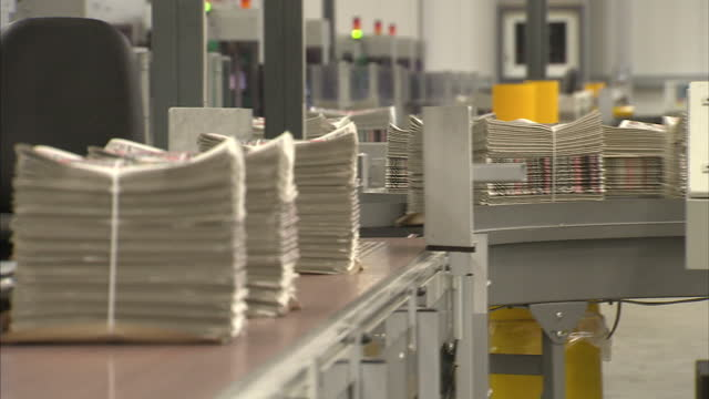 interior shots final edition of the news of the world on the printing press conveyor belts news of the world final edition at press on july 09, 2011... - news of the world stock-videos und b-roll-filmmaterial