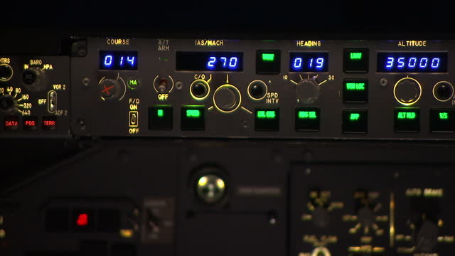 Interior shots flying instructor inside flight simulator Interior close up shots flight controls showing Course Mach Heading compass throttles...