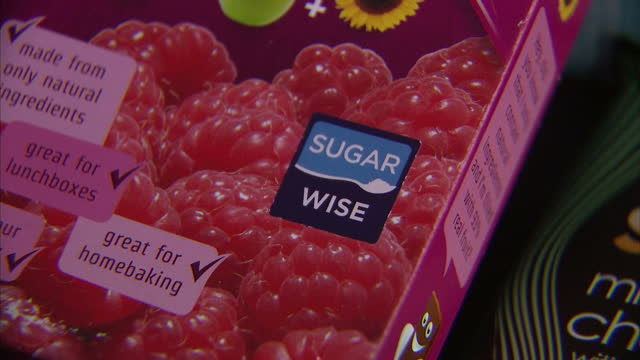 interior shots foods in packaging w/ 'no added sugar' and 'sugar free' labels, no added sugar chocolates, baked beans on march 11, 2016 in london,... - label stock videos & royalty-free footage
