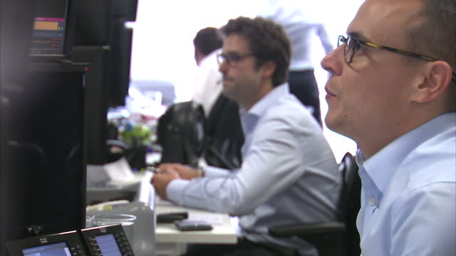 interior shots foreign exchange traders working in monex europe offices on october 04 2016 in london england - pound sterling symbol stock videos & royalty-free footage