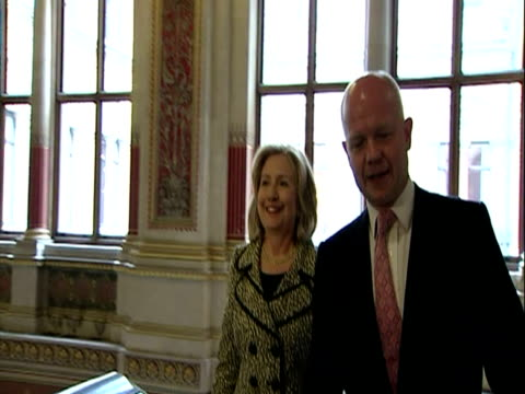 Interior shots Foreign Secretary William Hague US Secretary of State Hillary Clinton walk up stairs of the Foreign Office into room where they greet...