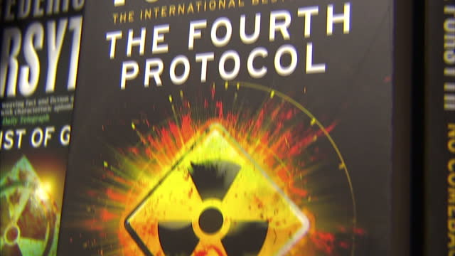 vídeos de stock e filmes b-roll de interior shots frederick forsyth books novels on shelf including the day of the jackal the fourth protocol the fist of god on august 30 2015 in high... - frederick forsyth