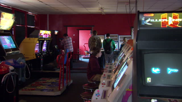 Interior shots gamers in video game arcade playing classic video games on October 11 2015 in London England