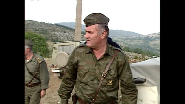 interior shots general ratko mladic gets out of vehicle and greets bosnian-serb soldiers at countryside outpost. on september 25, 1992 in bosnia and... - ratko mladic stock videos & royalty-free footage
