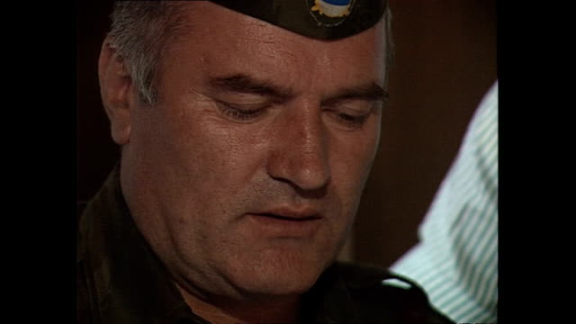 interior shots general ratko mladic looking at maps whilst sat at table with aernout van lynden journalist looking over his shoulder on september 25... - ratko mladic stock videos & royalty-free footage