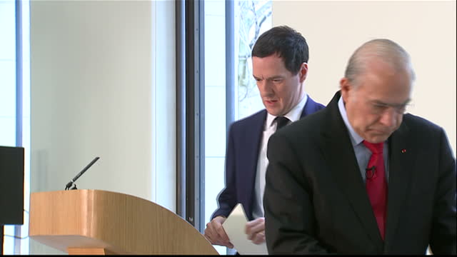 Interior shots George Osborne MP Chancellor of the Exchequer speaking Jose Angel Gurria Secretary General of OECD at conference unveiling OECD's UK...
