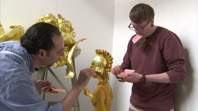interior shots gold leaf covered royal cypher which will go on the front of the royal barge. interior close up shot eiir insignia emblazoned on the... - gold leaf stock videos & royalty-free footage