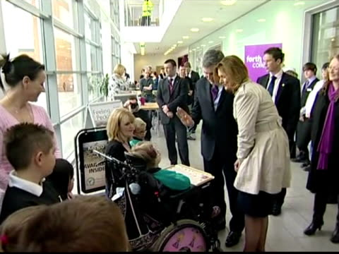 interior shots gordon brown his wife sarah chat with person in wheelchair pose for photocall interior shots gordon sarah brown shake hands with... - スコットランド スターリング点の映像素材/bロール