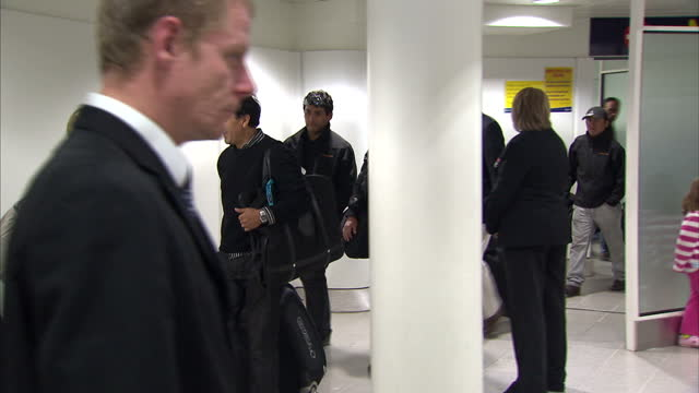 interior shots group of men that were rescued from the mine in chile arrive at manchester airport terminal greeting waiting reporters chile miners... - 1 minute or greater stock videos & royalty-free footage