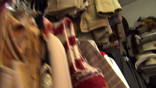 interior shots halloween costumes for sale in shop with customers browsing through racks of clothes and masks on display on october 14 2014 in london... - for sale frase inglese video stock e b–roll