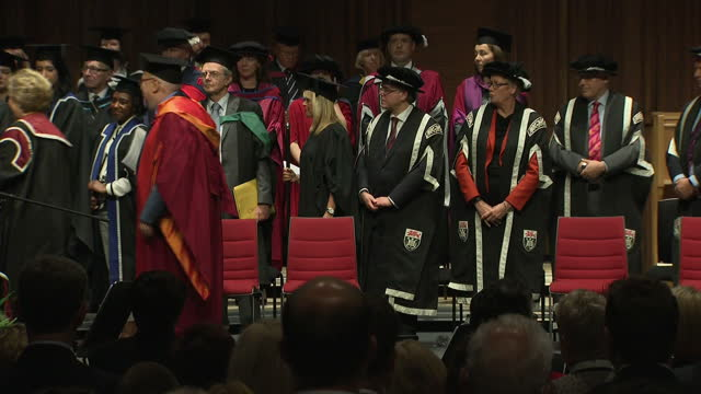 Interior shots Hillary Clinton 2016 American Presidential Candidate leaves stage after being presented with an Honorary Doctorate of Law from Swansea...