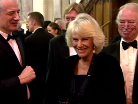 interior shots hrh camilla duchess of cornwall holding a glass of red wine and speaking to guests at the man booker prize eleanor catton became the... - man booker prize stock videos & royalty-free footage