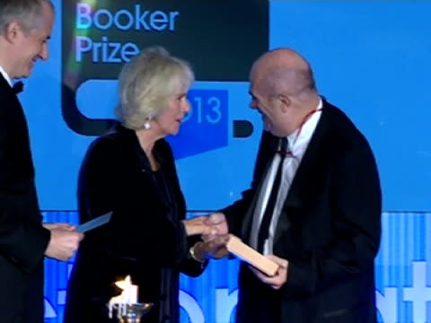 interior shots hrh camilla duchess of cornwall presents colm toibin author of testament of mary an award at the man booker prize eleanor catton... - man booker prize stock videos & royalty-free footage