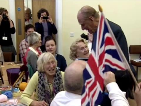Interior shots HRH Prince Philip Duke of Edinburgh speaking to pensioners in an elderly care centre in Norfolk Prince Philip speaking to elderly...