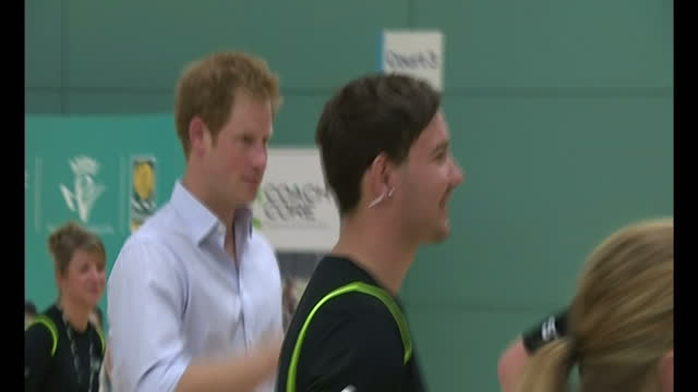 interior shots interior shots Prince Harry stood in circle taking it in turns to strike pads during boxing session