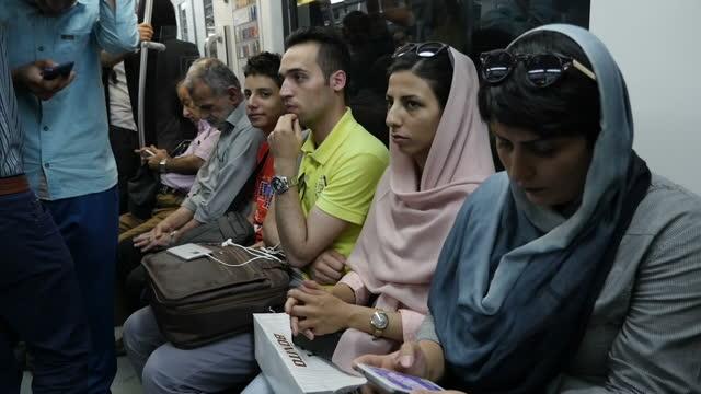 interior shots iranian people passengers travellers on underground metro station platform inside busy metro carriage on july 29 2016 in tehran iran - bahnreisender stock-videos und b-roll-filmmaterial