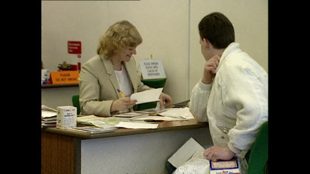 Interior shots job seeker sitting at desk talking with job centre staff member on February 16 1989 in Hounslow United Kingdom