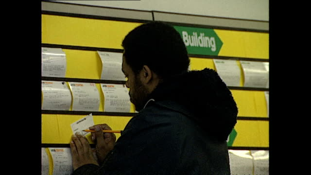 Interior shots job seekers looking at job advertisement boards in Job Center branch on February 16 1989 in Hounslow United Kingdom