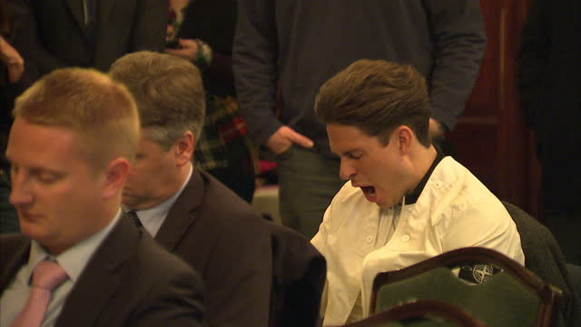 Interior shots Joey Essex star of The Only Way Is Essex sitting listening to speech by Nick Clegg looking bored and restless yawns during speech on...