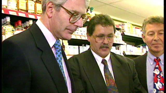 stockvideo's en b-roll-footage met interior shots, john major in a corner shop is shown how lottery tickets are printed and processed, in advance of the launch of the national lottery... - loterijlootje