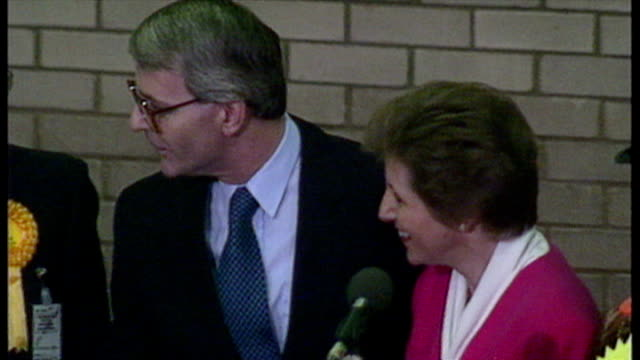 interior shots john major prime minister celebrating on stage after being reelected in his huntingdon constituency at the 1992 general election with... - john major stock-videos und b-roll-filmmaterial