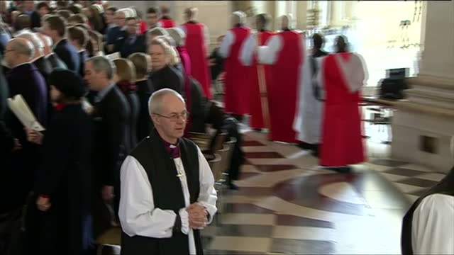 interior shots justin welby, archbishop of canterbury, walks through st paul's cathedral blessing congregation justin welby blesses congregation at... - archbishop of canterbury stock videos & royalty-free footage