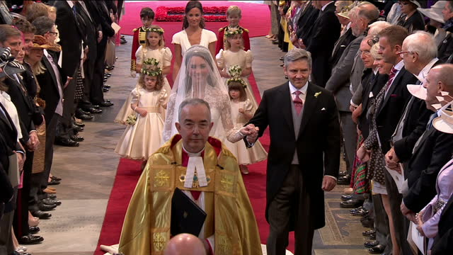 interior shots kate middleton walks with her father michael through westminster abbey up to the altar where she stands next to prince william... - duchess of cambridge stock videos & royalty-free footage