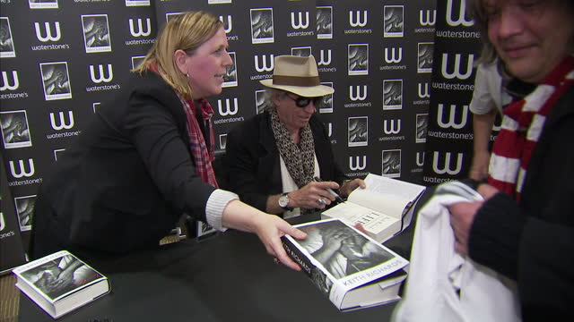 "interior shots keith richards signs copies of his autobiography ""life"" for fans in waterstones keith richards sign copies of his book life on... - autobiography stock videos & royalty-free footage"