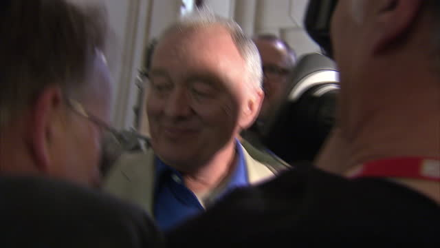 interior shots ken livingstone former labour london mayor surrounded by media as he tries to leave building and is repeatedly asked questions over... - mayor stock videos and b-roll footage