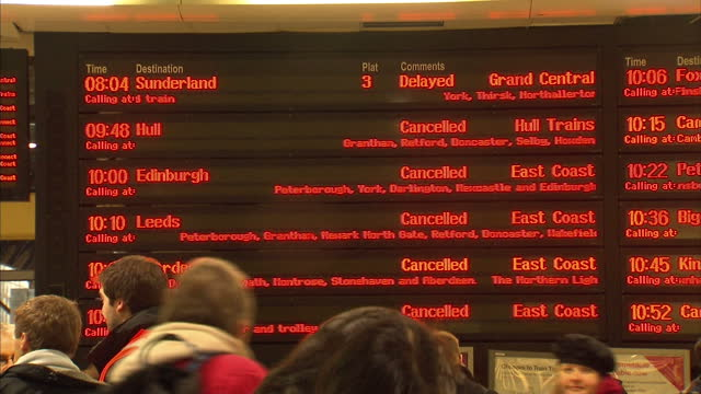 interior shots kings cross station departure board showing cancelled trains kings cross station cancellations on december 21 2010 in london england - キングスクロス駅点の映像素材/bロール